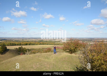 Pegsdon, UK. 01st Oct, 2018. A female runner taking a selfie photo at the top of the Pegsdon Hills and Hoo Bit Nature Reserve a popular spot with runners near the village of Pegsdon, Hertfordshire, England Credit: Martin Parker/Alamy Live News - Stock Photo