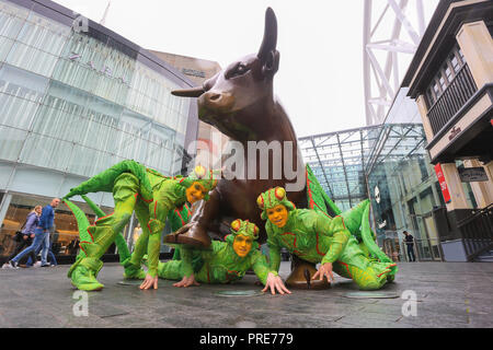Birmingham, UK. 2nd October, 2018. Three of the cast of crickets in Cirque de Soleil's OVO show arrive in Birmingham Bull Ring ahead of their premiere performance on Wednesday 3rd October in The Arena, Birmingham. The production of one of the world's most creative and skilful circuses runs from 3rd - 7th October 2018. Peter Lopeman/Alamy Live News - Stock Photo