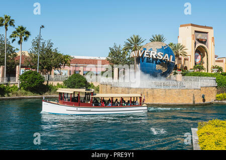 ORLANDO, FLORIDA, USA - DECEMBER, 2017: Iconic Universal Studios globe located at the entrance to the theme park in a beautiful sunlight day. - Stock Photo