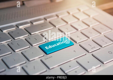 Writing note showing Education. Business photo showcasing Teaching of students by implementation of latest technology written on Blue Key Button on gr - Stock Photo