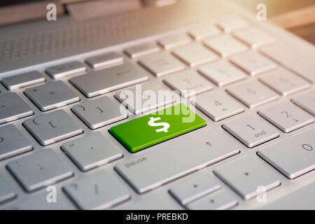 Closeup of computer keyboard with dollar button. Color button on the gray silver keyboard of modern ultrabook. caption on the button - Stock Photo