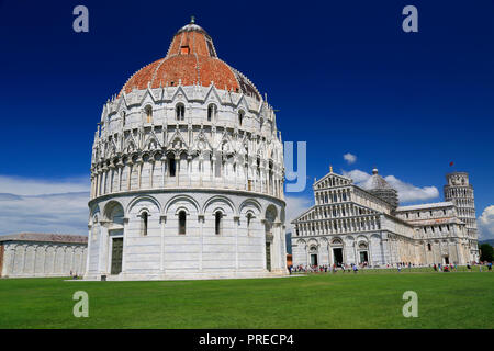 Piazza del Duomo in Pisa, Baptistery and Basilica, Italy - Stock Photo