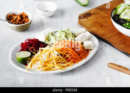 Cooking vegetarian buddha bowl concept with spiralized vegetables - Stock Photo