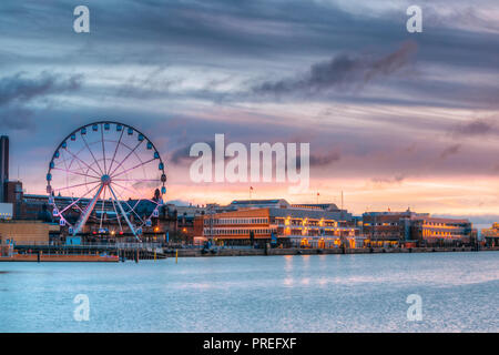 Helsinki, Finland. View Of Embankment With Ferris Wheel In Morning Sunrise Time. - Stock Photo