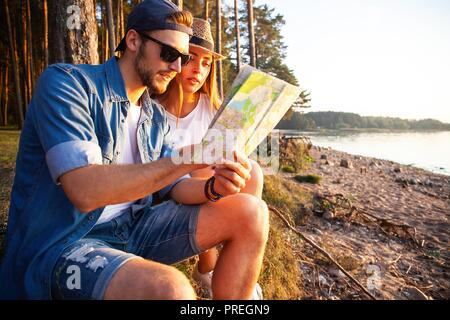Happy couple going on a hike together in a forest.