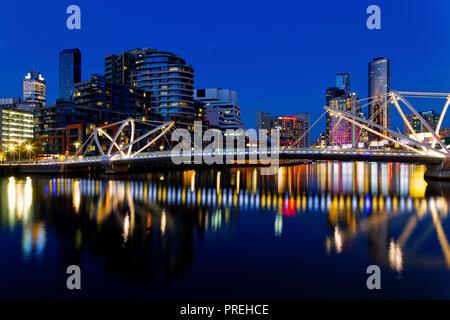 Seafarers Bridge Reflections, Melbourne City CBD, Dusk Cityscape from Docklands, Victoira, Australia - Stock Photo