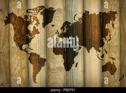 Shadow of a world map projecting on wooden planks as a background - Stock Photo