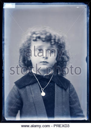 portrait of a girlie looking young boy with curly hair France circa 1920s - Stock Photo