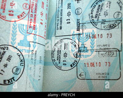 Border marks on the pages of Israeli foreign passport - Stock Photo