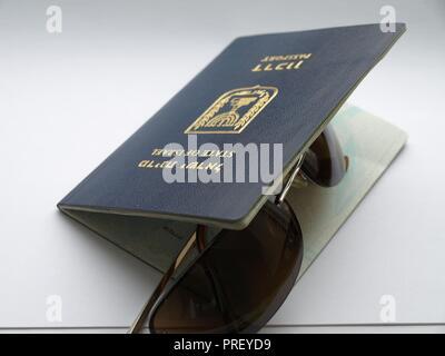 Israeli passport (translation: State of Israel. Passport) and glasses from the sun. - Stock Photo