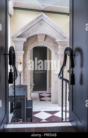 Stone pediment, originally a window surround as entrance to shower - Stock Photo