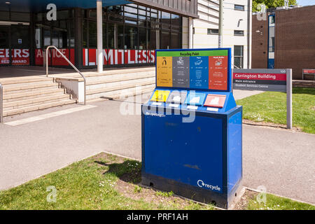 Recycling point on university campus with separate bins for litter, paper, cans and plastic bottles - Stock Photo
