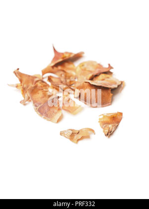 Seeds of a nordmann fir tree on a white table - Stock Photo