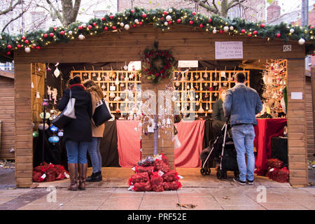 York, UK – 12 Dec 2016: Christmas Shoppers at St Nicholas Christmas Market on 12 Dec at St Sampson's Square, York - Stock Photo