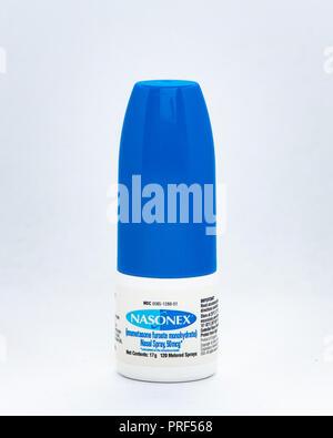 A prescription  bottle of Nasonex Nasal Spray for treatment of nasal congestion. - Stock Photo