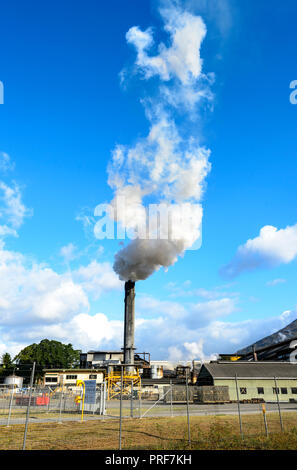 Smoking Stack during sugarcane crushing at Mulgrave Mill MSF Sugar Mill in Gordonvale, near Cairns, Far North Queensland, FNQ, QLD, Australia - Stock Photo