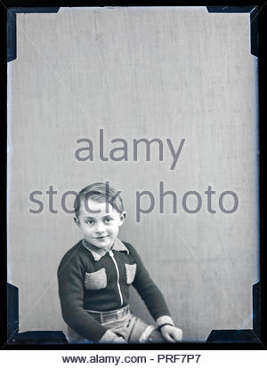 young boy posing for a studio portrait circa 1930s - Stock Photo