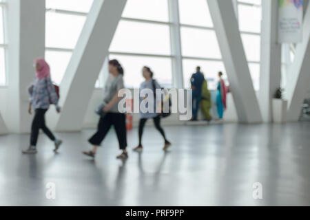 Unrecognizable people walking through the airport hall. Malaysia, KLIA. - Stock Photo