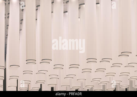 Lighting Interior Design. Hanging ceiling lamp in airport. Modern lighting decor, cylindrical lampshade. - Stock Photo