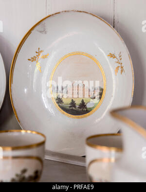 Hand painted crockery with facade of Milton Hall - Stock Photo