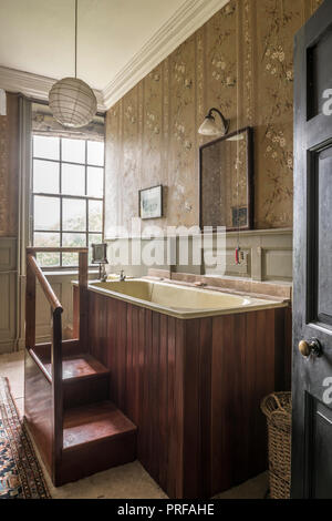 1940s raised bath to allow bather view from window - Stock Photo