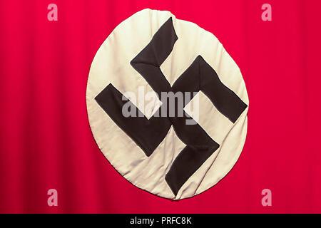 Krakow, Poland - June 3, 2018: Nazi Swastika - flag in Oskar Schindler's Enamel factory museum - Stock Photo