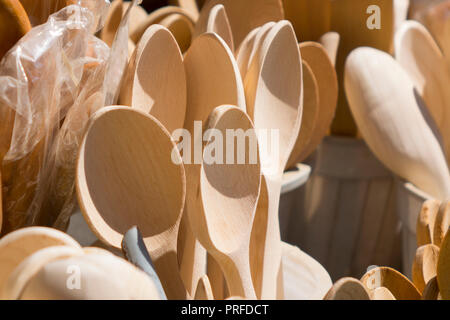 Handmade wooden kitchenware in a bazaar - Stock Photo