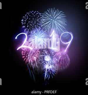 Celebrating the new year 2019 with a dazzling fireworks display. - Stock Photo