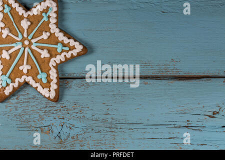 Single Gingerbread Cookie on Blue Wooden Background.Copy Space - Stock Photo