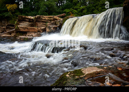 Water flows over Richmond falls along the river Swale in Richmond, North Yorkshire UK. - Stock Photo