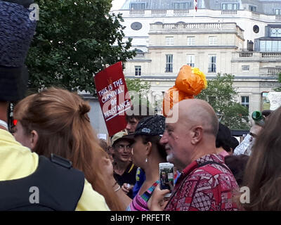 London UK, 13th July 2018. 100,000 people protest against the visit of the US President Donald Trump. The protesters gather in Trafalgar Square. - Stock Photo