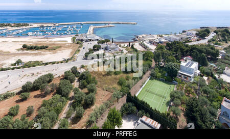 Beautiful drone view of harbor and beach side. Houses and buildings with solar panels built next to ocean or sea. Luxury lifestyle. Concept of travell - Stock Photo
