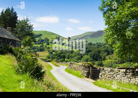 Newlands valley Cumbria, looking south-west from Littletown down the length of an unclassifed road towards High Snab Bank. - Stock Photo