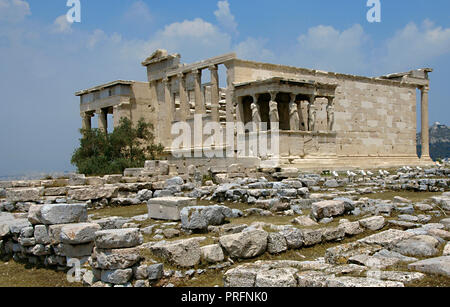 Greece. Athens. Acropolis. Erechtheion. Ionic temple which was built in 421 BC by Athenian architect Mnesicles (Pericles Age). Kariatides (Porch of the Caryatids). General view. - Stock Photo