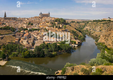Toledo, Toledo Province, Castilla-La Mancha Spain.  Overall view of the historic centre showing the Tagus River (Rio Tajo) and the Alcazar.  The cathe - Stock Photo