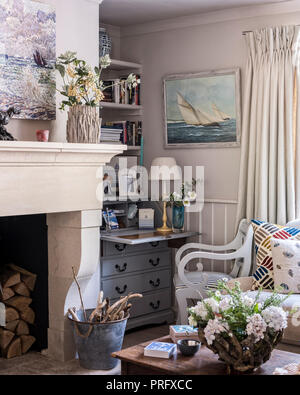 Writing desk and chair with cut flowers in Devon cottage - Stock Photo