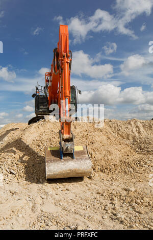Excavator digger on building construction site. UK. unsharpened - Stock Photo