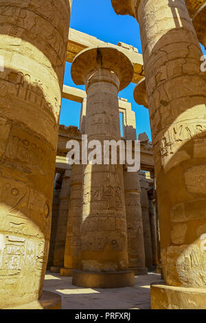 The Hypostyle Hall in the Temple of Amun at the Karnak Temple Complex, also known as The Temple of Karnak, in Thebes, Luxor, Egypt - Stock Photo