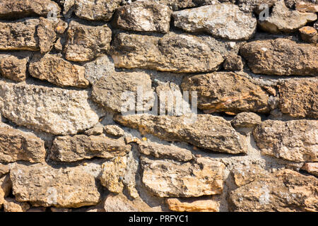 pattern gray color of modern style design decorative cracked real stone wall surface with cement - Stock Photo