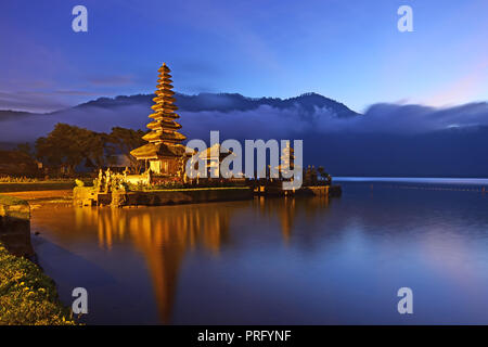 Sunrise over beautiful Pura Ulun Danu Bratan temple in Bali Indonesia - Stock Photo