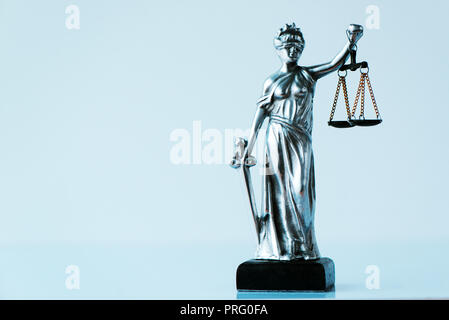 Lady Justice statue in law office. Figurine with blindfold, balance and sword is personification of moral force in judicial system and it's origin is  - Stock Photo
