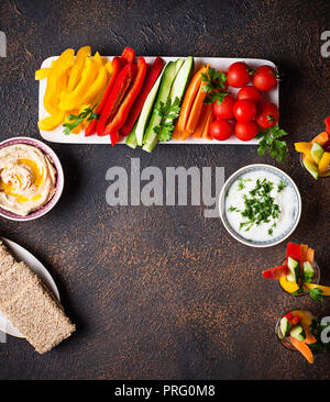 Healthy snacks. Vegetables and hummus - Stock Photo