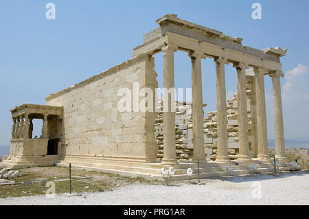 Greece. Athens. Acropolis. Erechtheion. Ionic temple which was built in 421 BC by Athenian architect Mnesicles (Pericles Age). Kariatides (Porch of the Caryatids). - Stock Photo