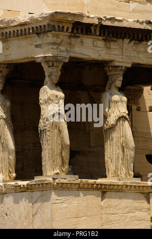 Greece. Athens. Acropolis. Erechtheion. Ionic temple which was built in 421 BC by Athenian architect Mnesicles (Pericles Age). Kariatides (Porch of the Caryatids). Architectural detail. - Stock Photo