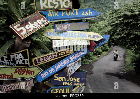 Artistic signpost in Amed, Bali, Indonesia - Stock Photo