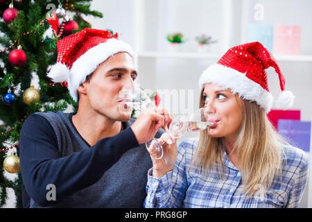Happy couple celebrating christmas at home - Stock Photo