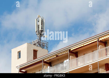 Mobile antennas in the top of a building - Stock Photo
