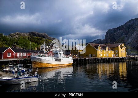 The village of Nusfjord in the Lofoten Islands where traditional rorbuer (fishermen's houses) have been restored and converted into holiday cottages. - Stock Photo