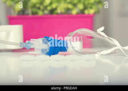 Mask for nebulizer. Home asthma treatment. Selective focus - Stock Photo