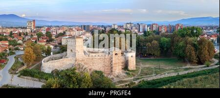 Large panorama of Pirot cityscape with ancient fortress and beautiful city park in the foreground - Stock Photo